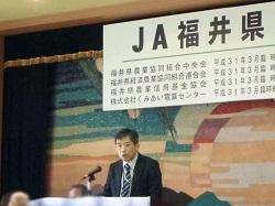 祝辞を述べる橋本地方参事官